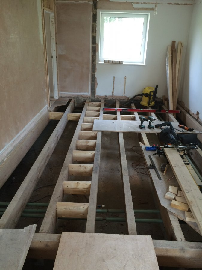 Plywood Subfloor Continuous Flooring Throughout Bungalow
