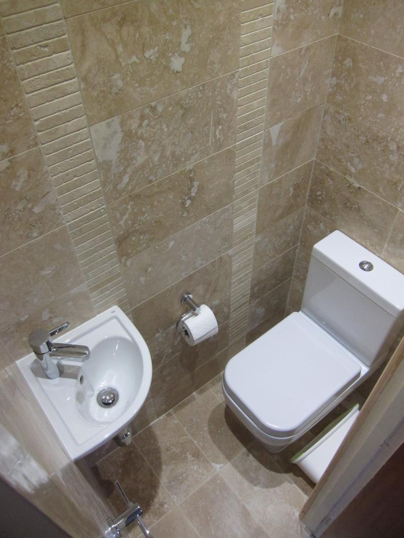 Small Cloakroom toilet - clever space saving sink with water recycling.