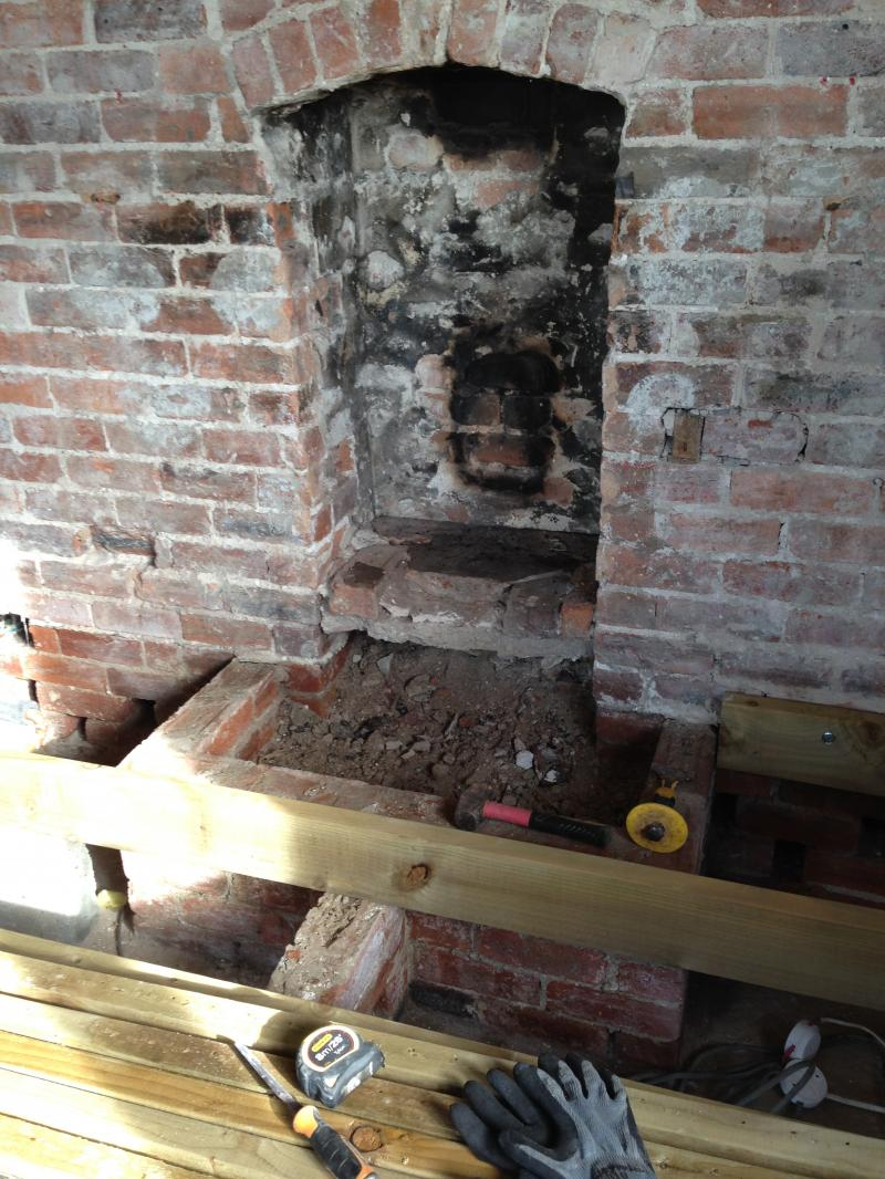 Can I insulate under concrete hearth? | DIYnot Forums