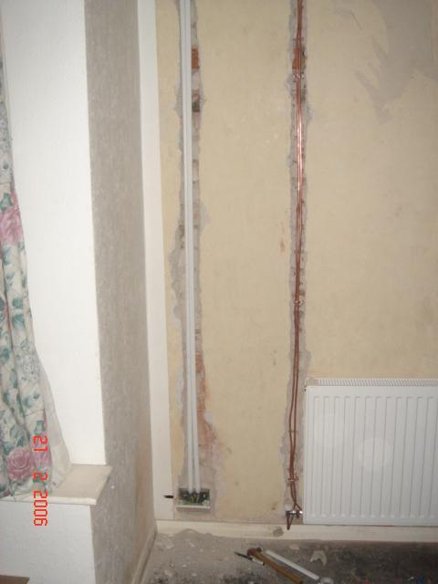Plastering Over Long Chases Of 20mm Oval Plastic Conduit